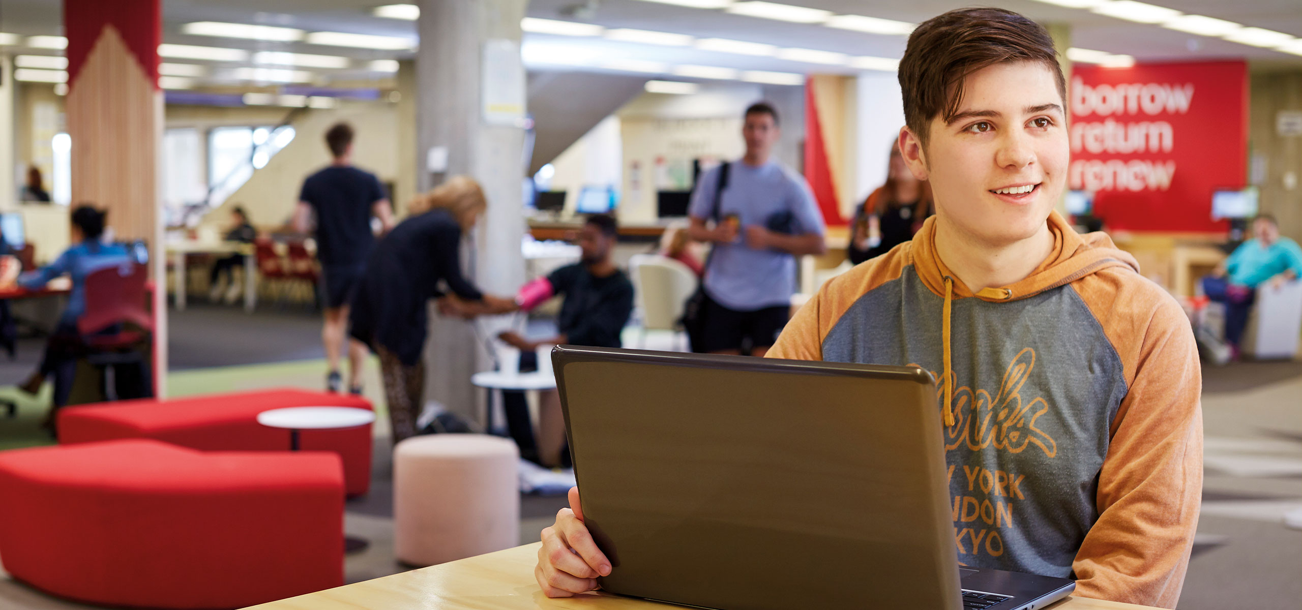 Student using laptop in Geoffrey Bolton Library