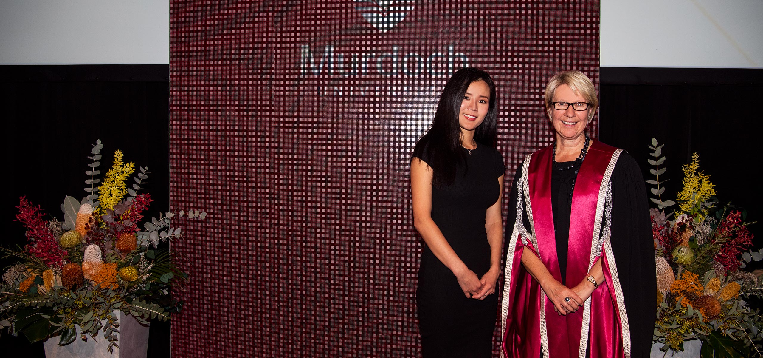 Academic excellence award recipient Wenna Lee with Vice Chancellor