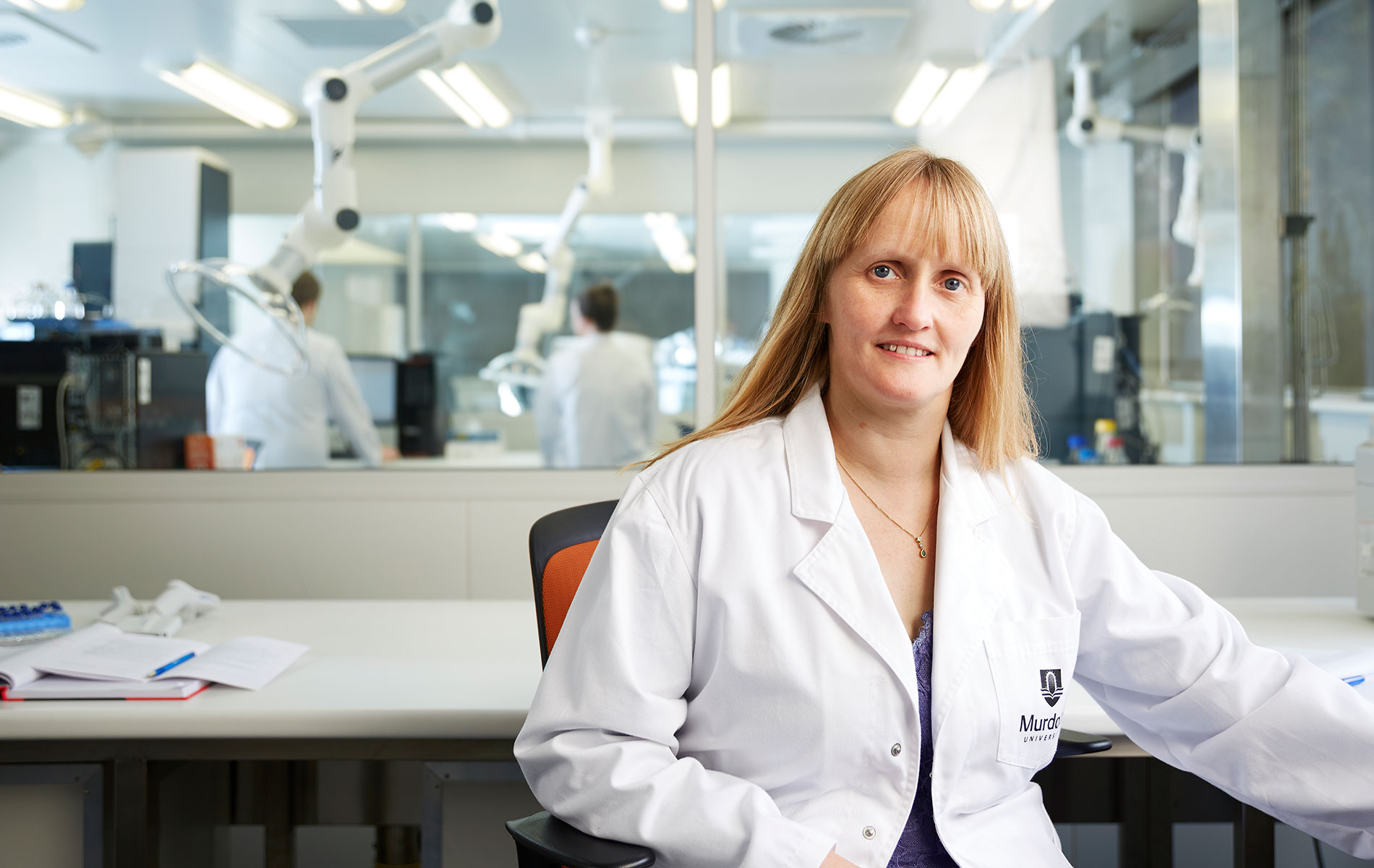 Murdoch University Professor Elaine Holmes sitting in the ANPC labs