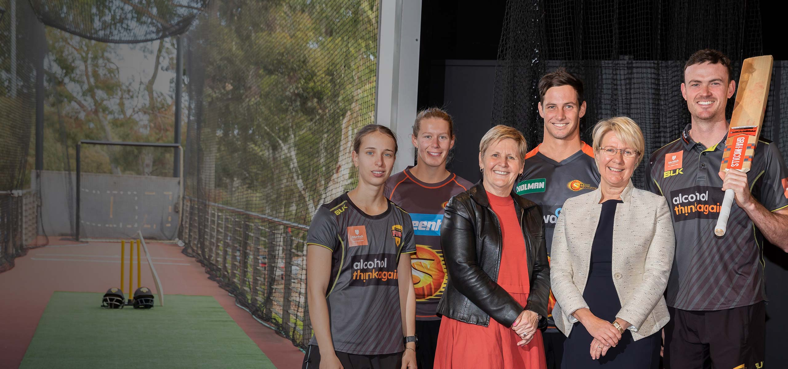 WACA players and chief executive with Murdoch Vice Chancellor Eeva Leinonen