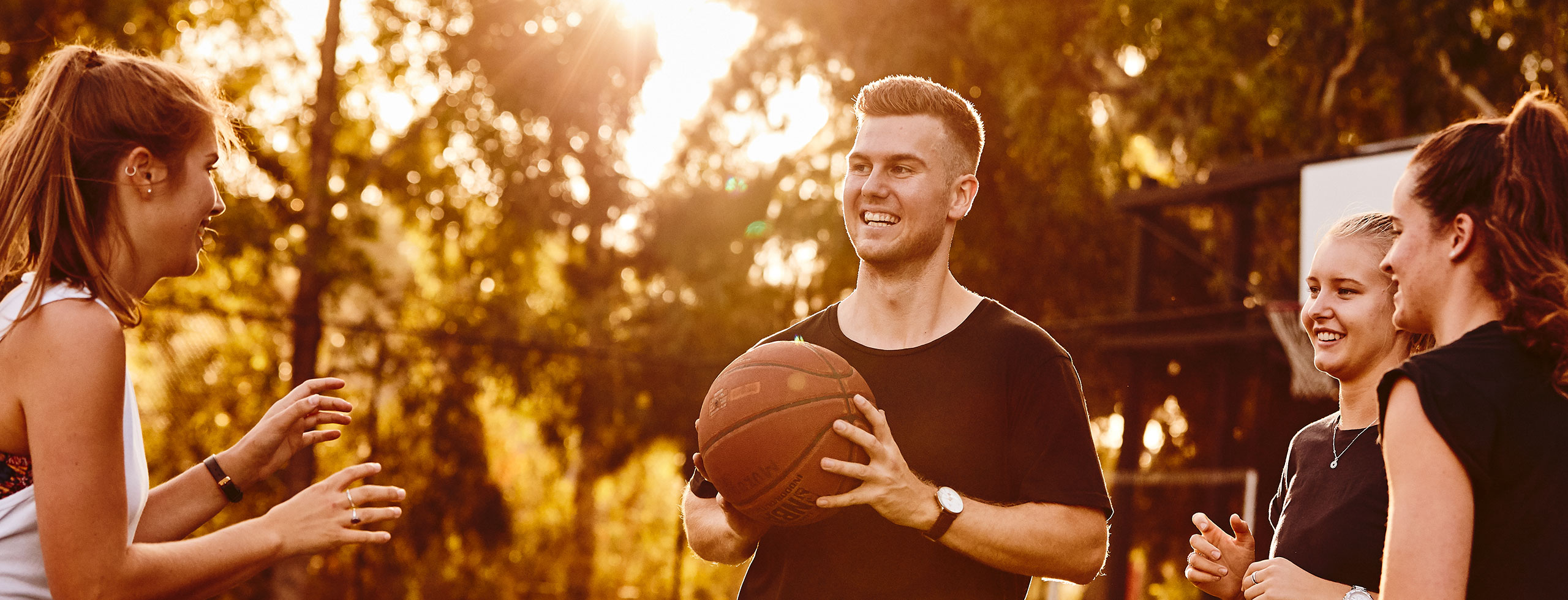 Ben Lewis playing basketball with friends