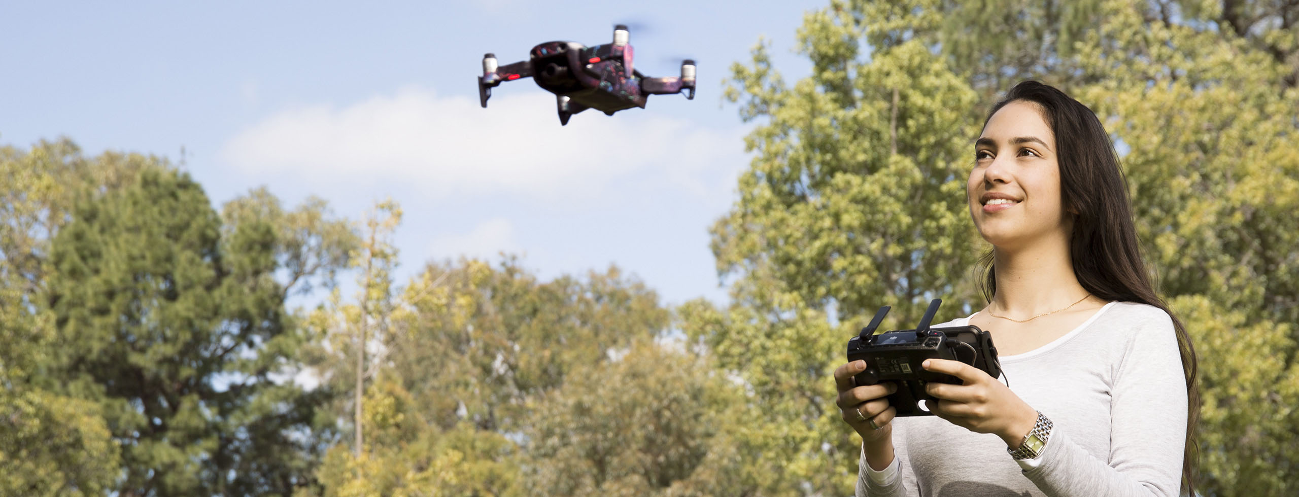 Girl driving a drone