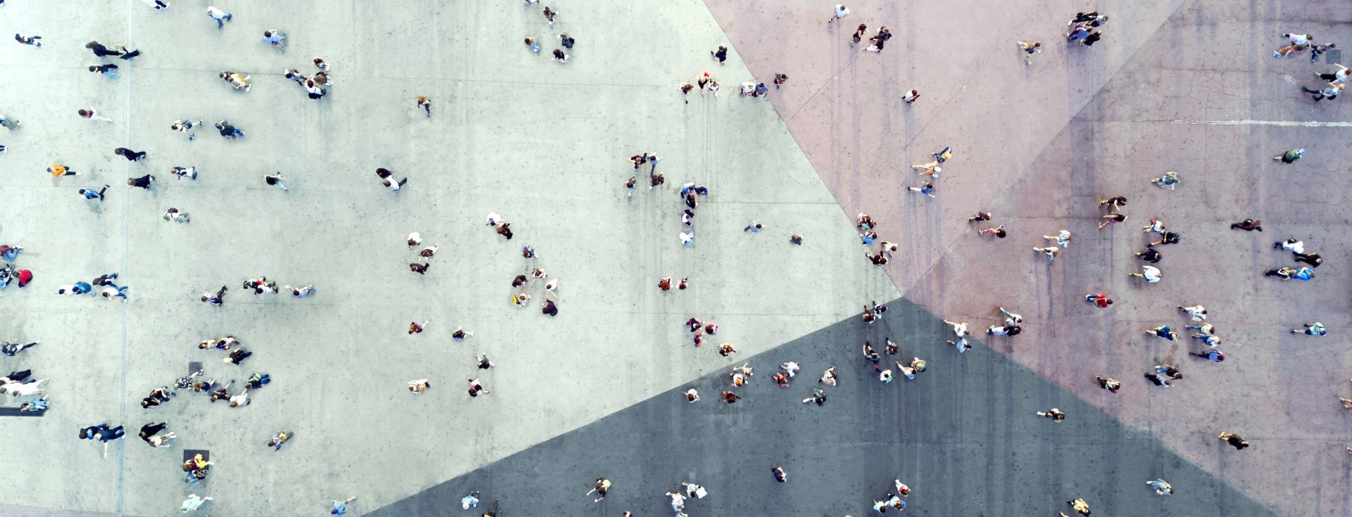 birds eye view of a group of people walking across pavement