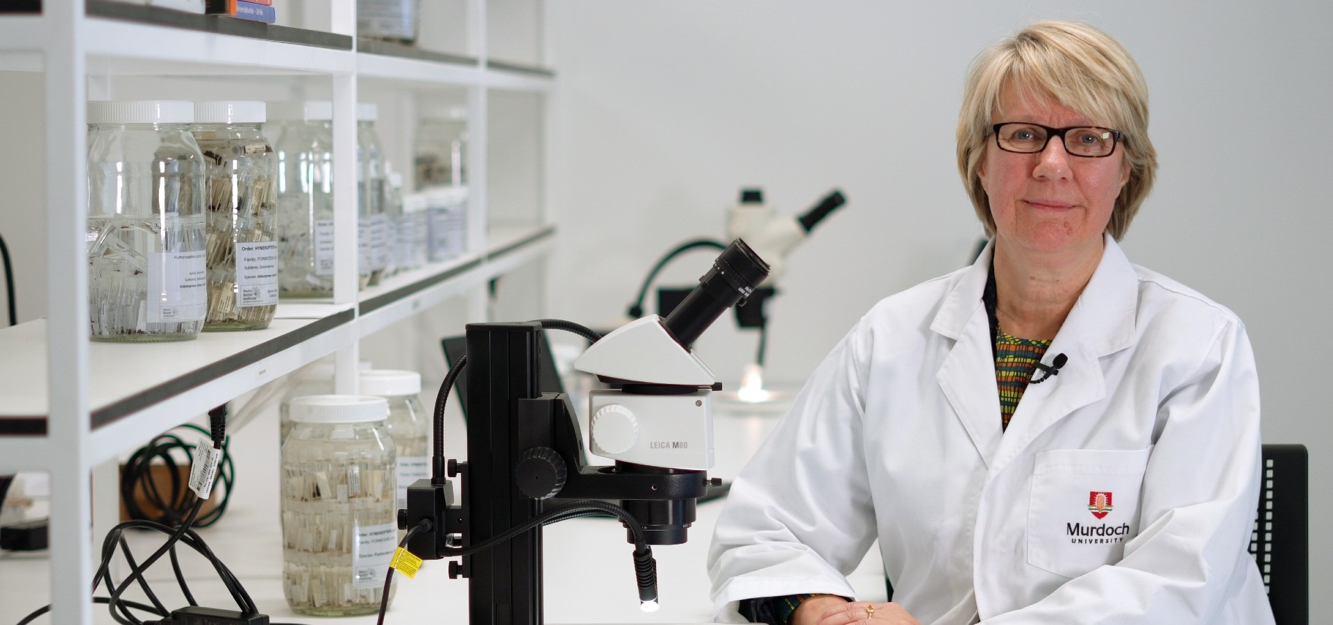 Vice Chancellor Professor Eeva Leinonen in a lab coat