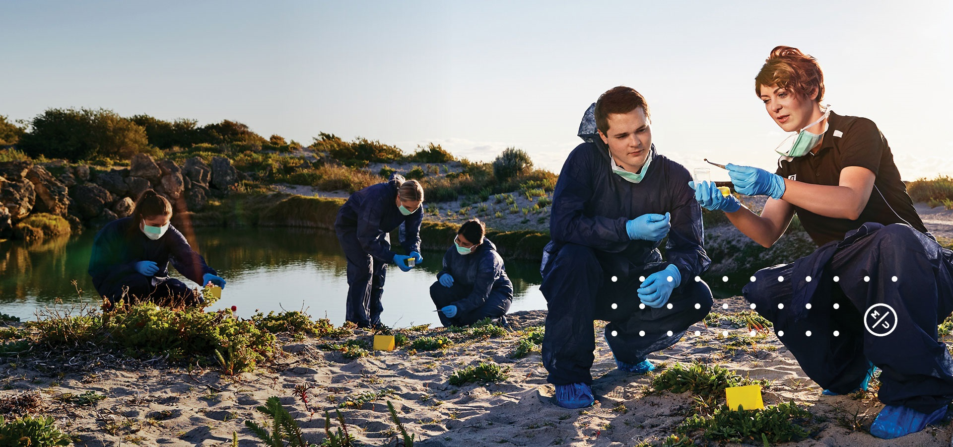 Paola Magni and students inspecting a fake crime scene at the wetlands