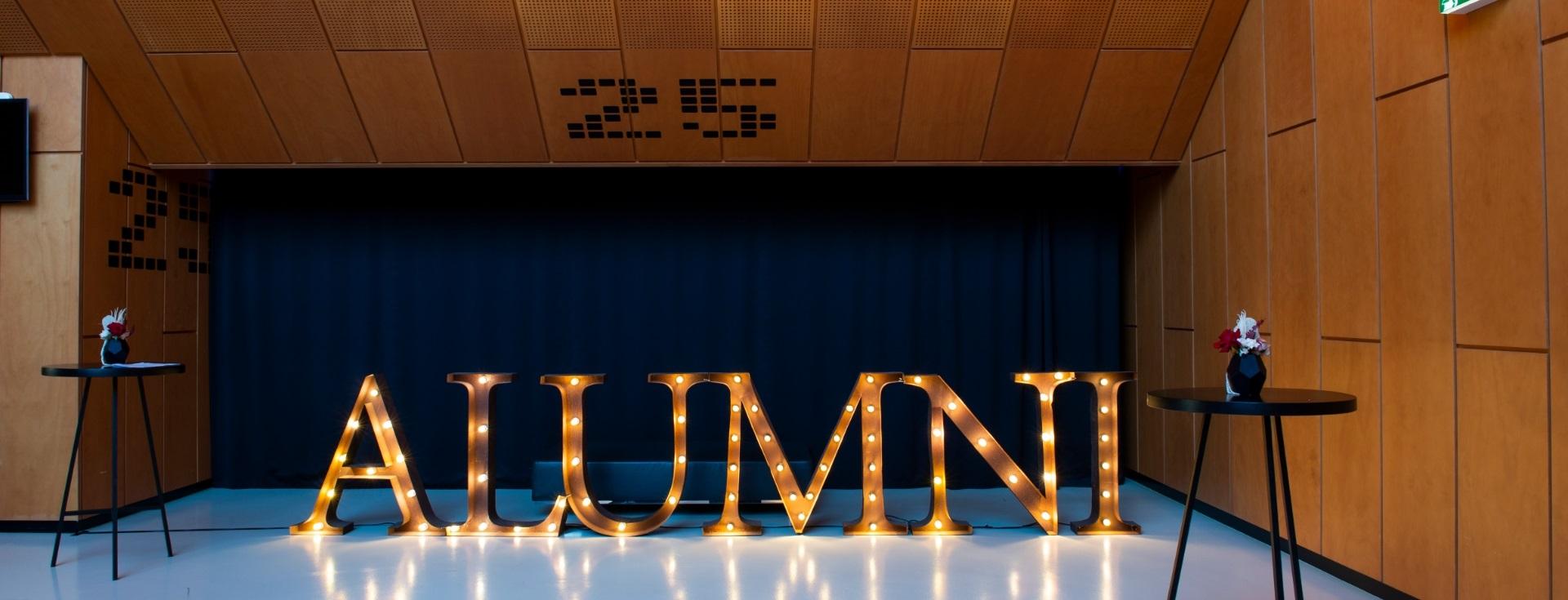 Alumni sign