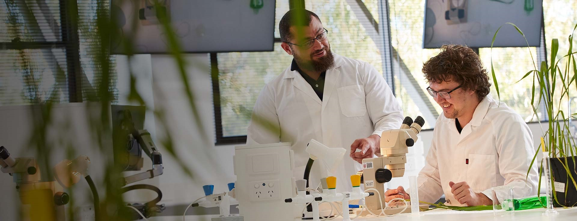 Murdoch student and lecturer in a science lab