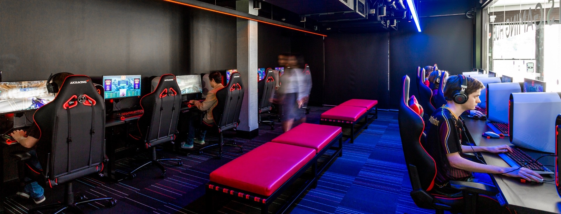 Students playing video games in esports hub