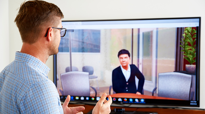 Man talking to computer screen