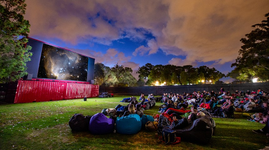 Guests on beanbags enjoy an evening movie at Murdoch's outdoor cinema