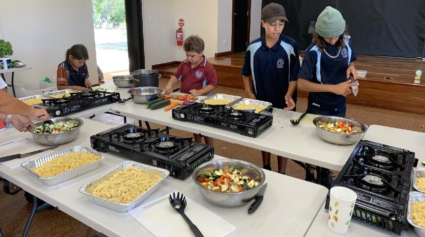 Aboriginal children participate in a cooking class