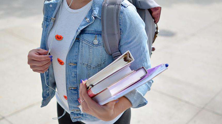Girl with backpack and books feature