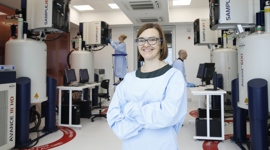Dr Nicola Gray stands in front of the NMR suite at the Australian National Phenome Centre