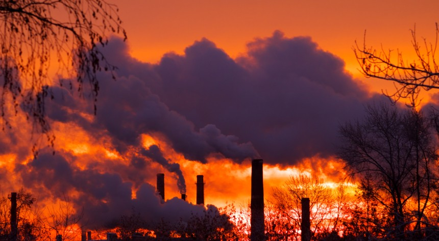 Emissions from smoke stacks at sunset
