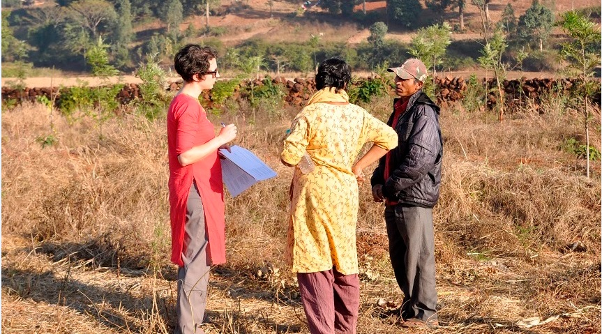 Erin Sweeney with farmers in India
