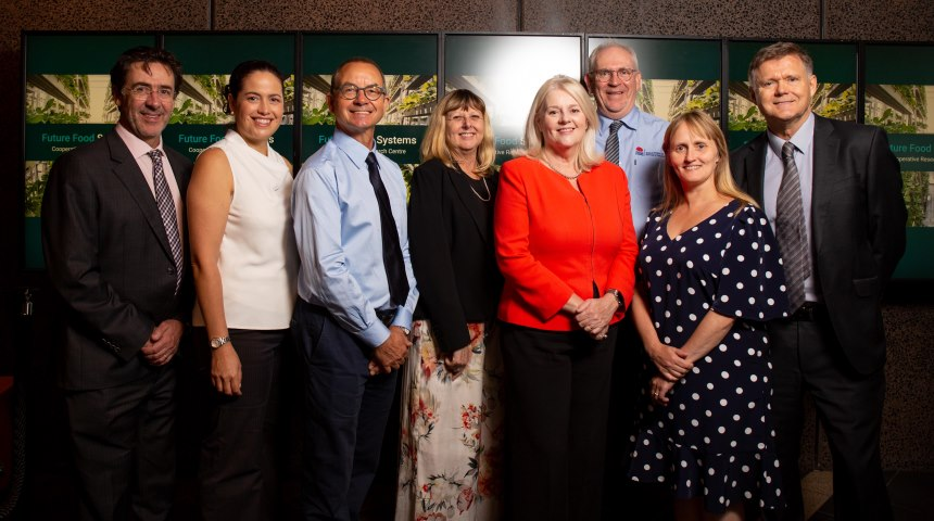 Professor Elaine Holmes with researchers and the minister
