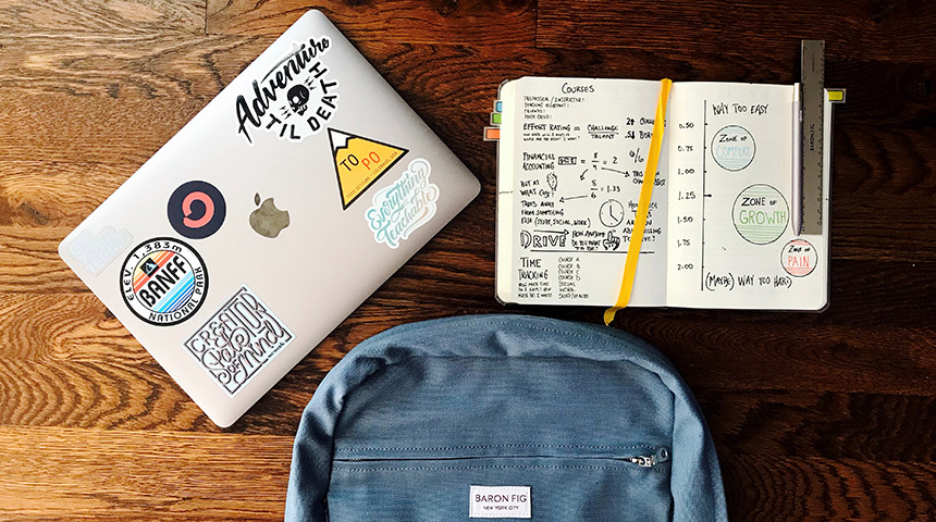 Overlay of books, backpack and laptop