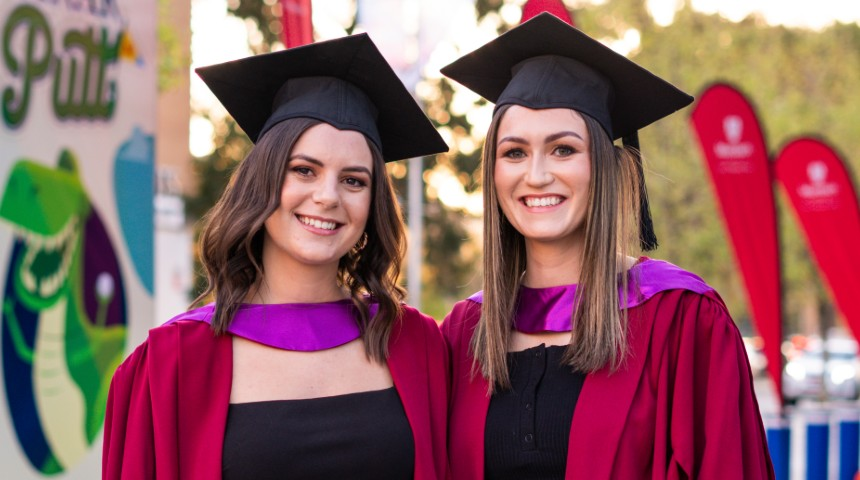 Two Murdoch graduates outside the arena before the ceremony