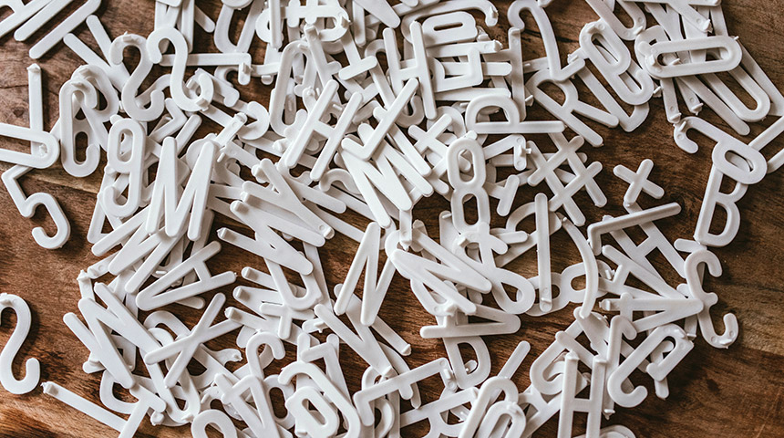 Letters from the alphabet jumbled in a mess on a table