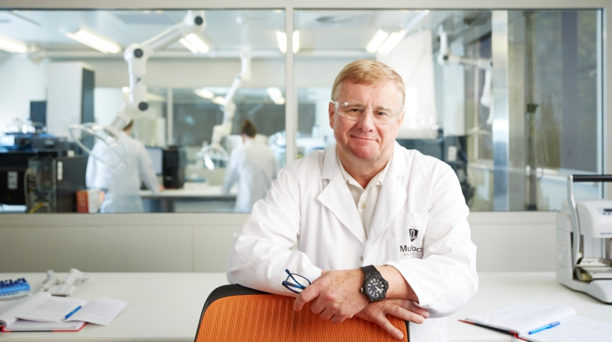Jeremy Nicholson smiling in a lab coat at the Australian National Phenome Centre