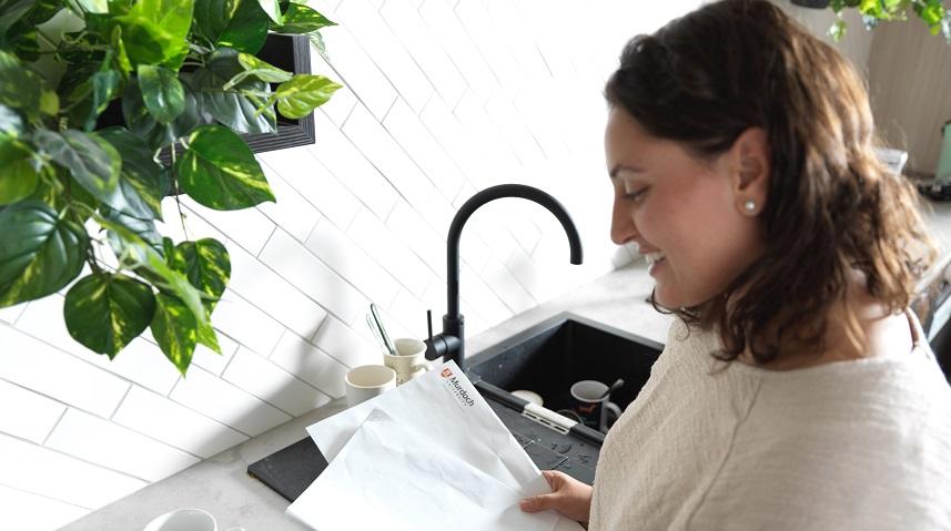 Genna Radnan looking at her Murdoch University acceptance letter