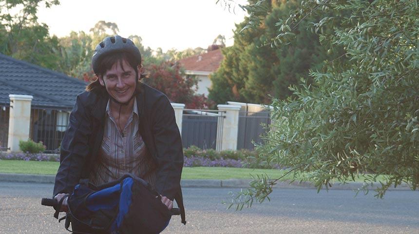 Martina Calais riding bike in suburbs