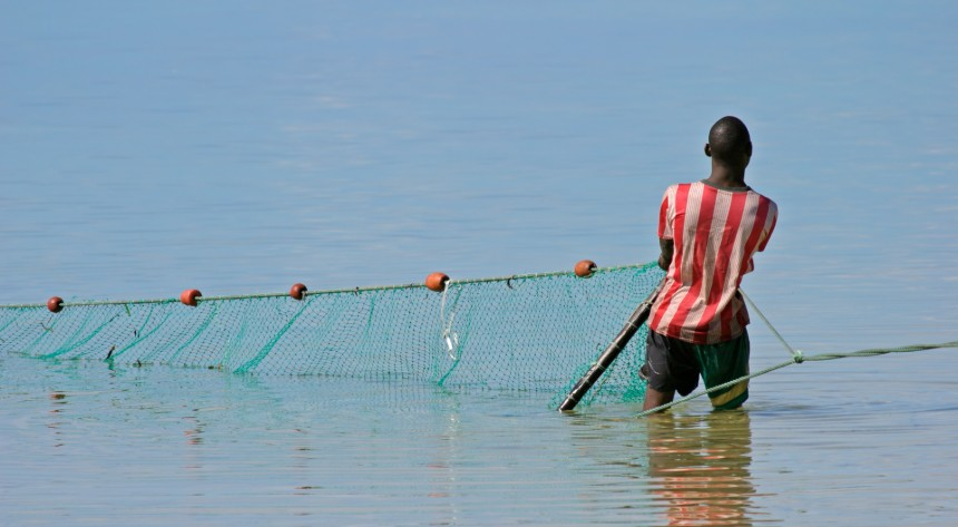 Fisherman pulling his net in Mozambique