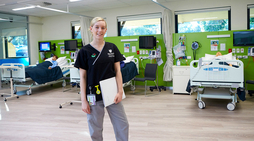 A Murdoch  University nursing student stands in the simulated ward