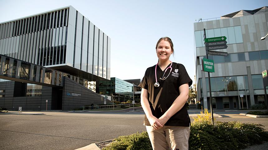 Murdoch nursing student standing in the Murdoch health precinct