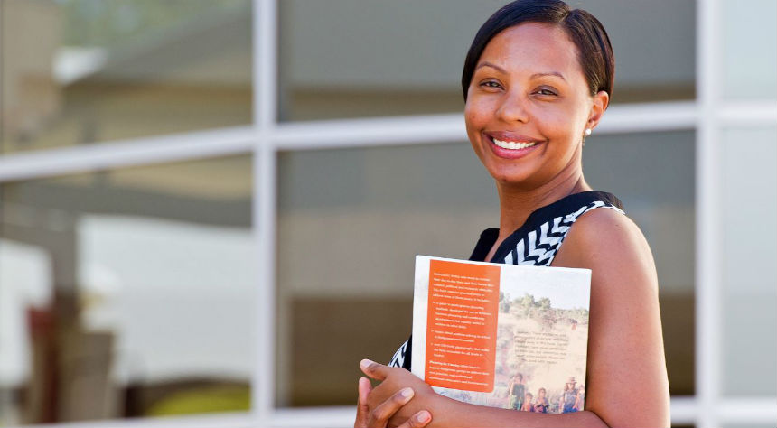 Smiling mature female student with brochure