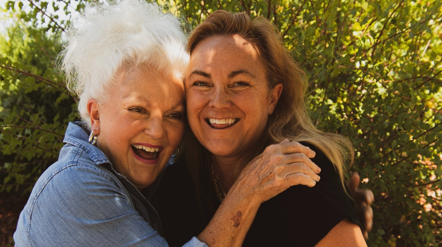 Old and young woman embracing and smiling