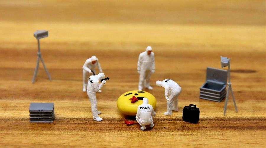 Toy figurines arranged in a crime scene