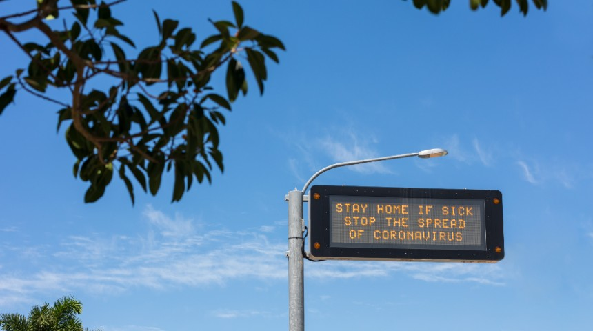 COVID-19 stay home warning road sign