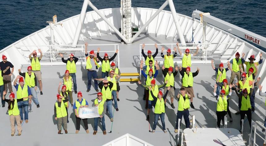 Aerial view of RV investigator crew waving