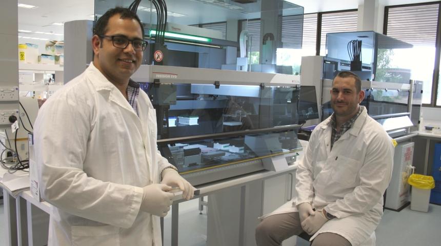 Associate Professor Sam Abraham and Dr Mark O'Dea standing near lab machinery