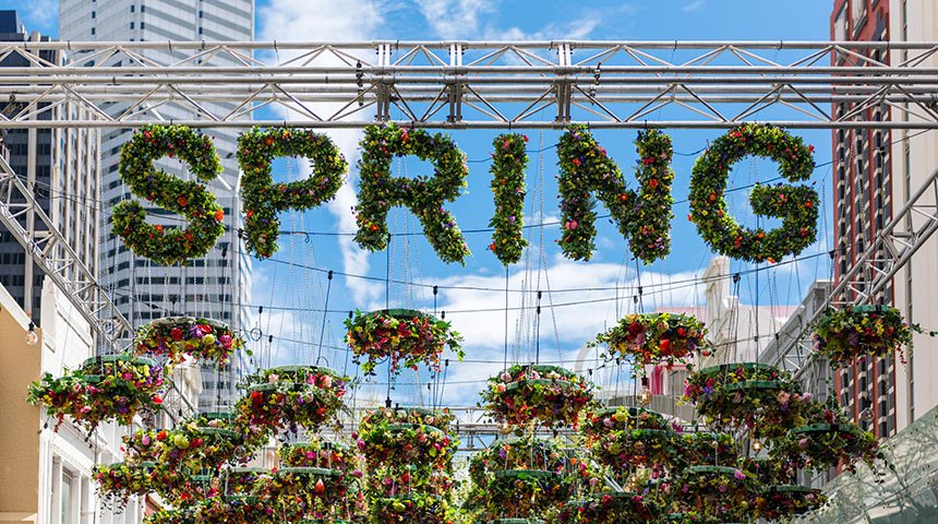 Hanging flowers that spell out spring under Perth buildings