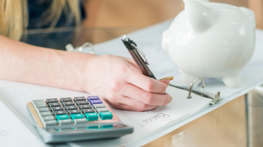 student support image with calculator and piggy bank