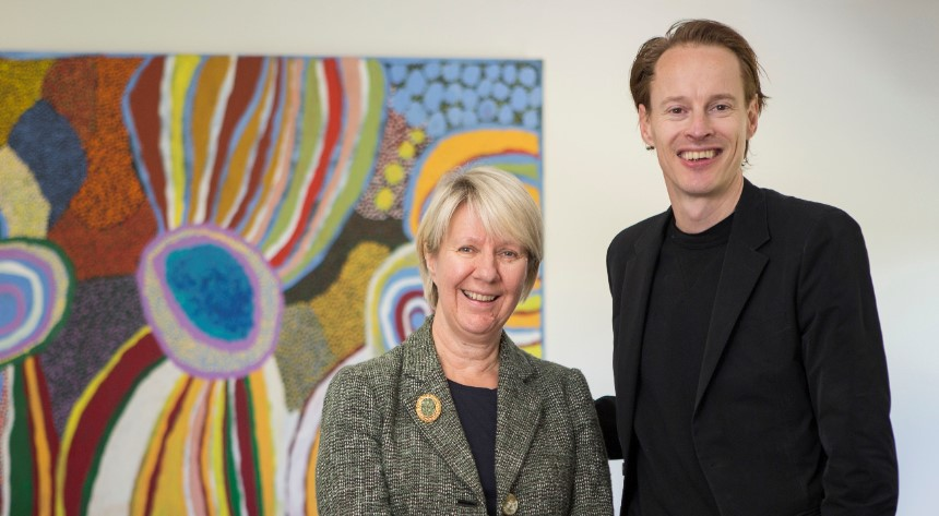 Vice Chancellor Eeva Leinonen with Daan Roosegaarde standing in front of a painting