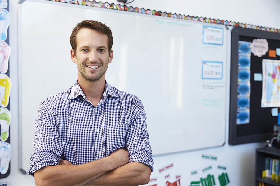 Male teacher in front of white board
