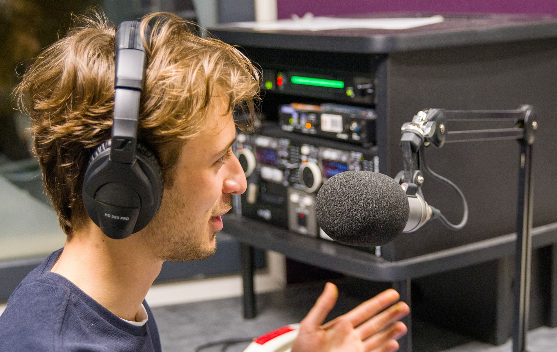 Alex recording a podcast on campus