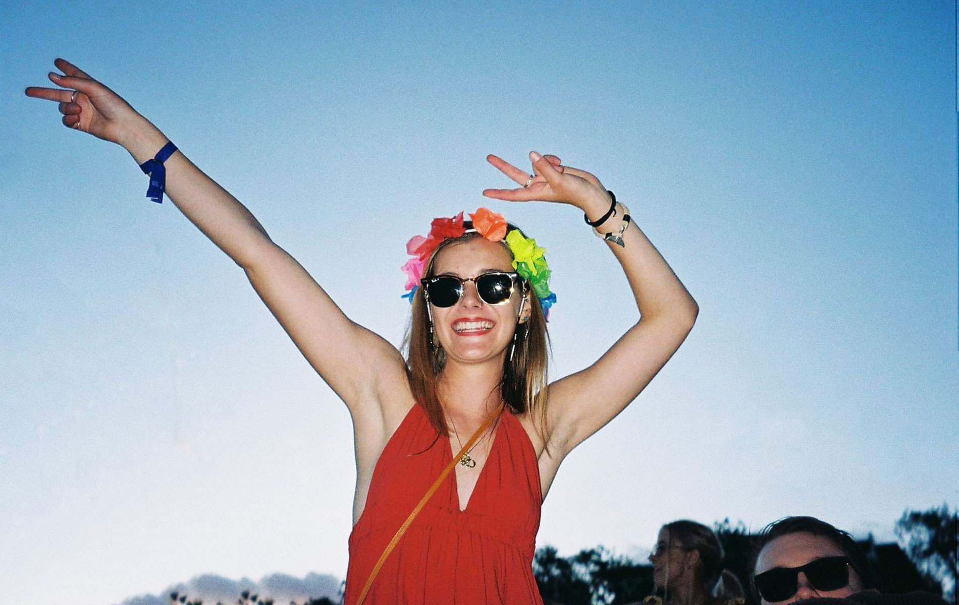 Gabby sitting on someones shoulders at a music festival