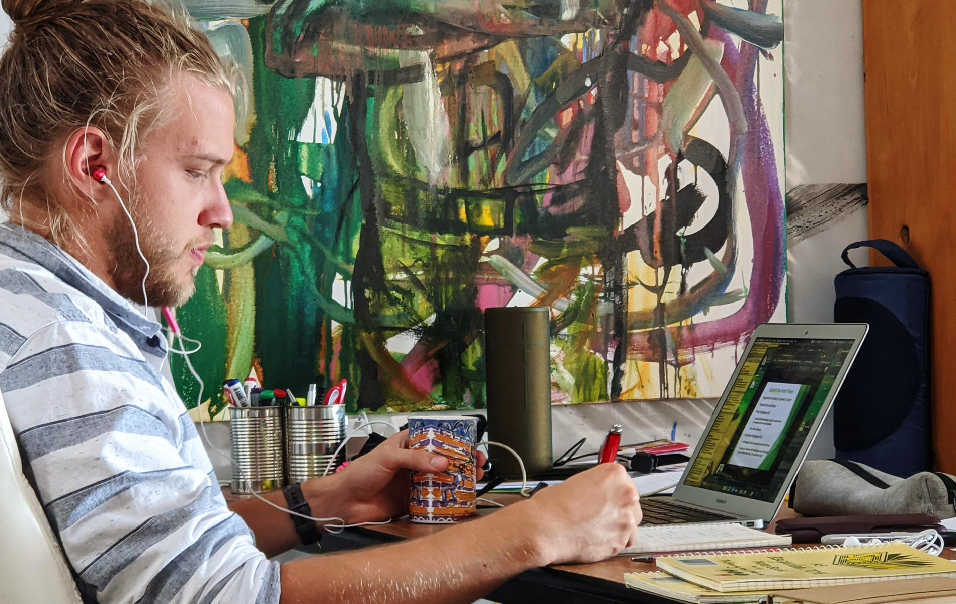 Murdoch student James Norton studying from home on his laptop