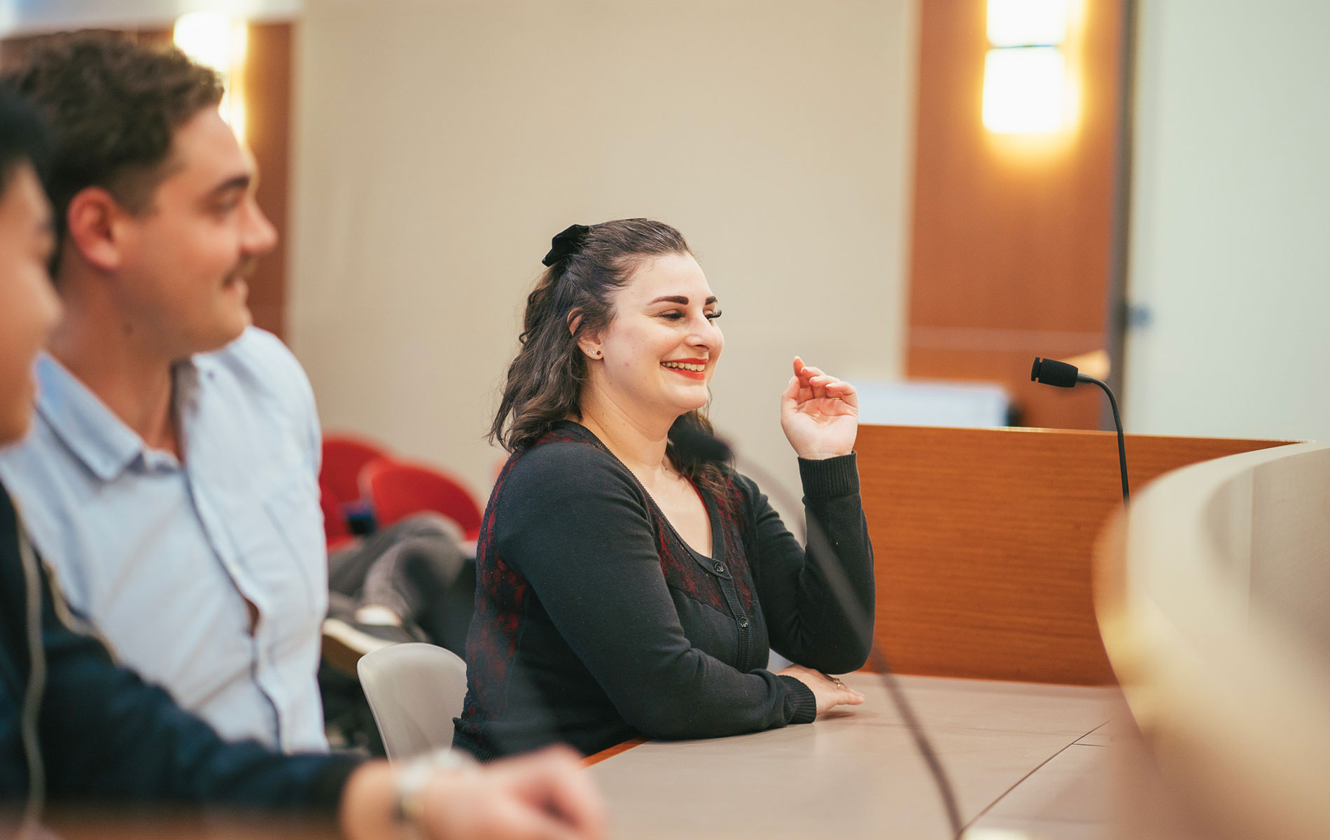 Rebecca sitting in moot court on campus