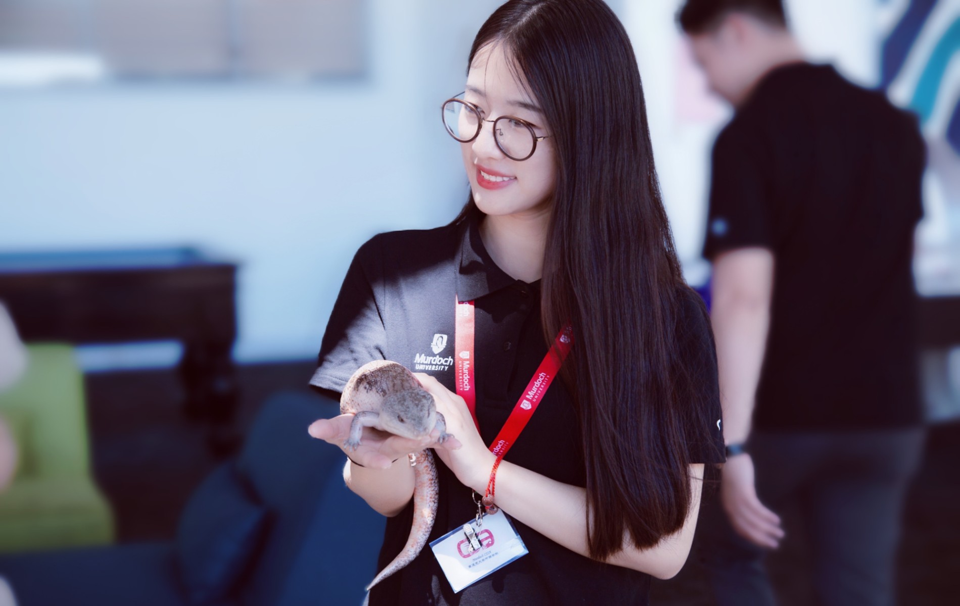 Shuang holding a reptile