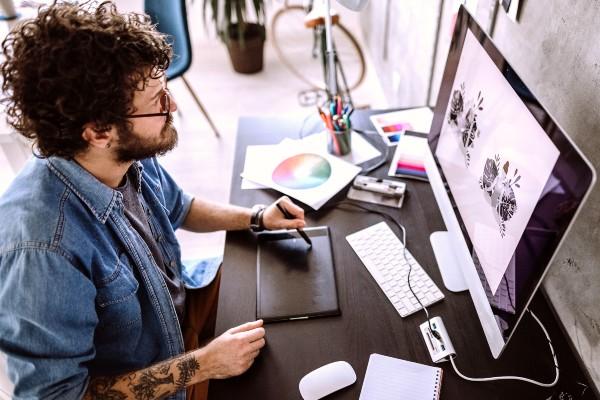Animator creating animation on computer