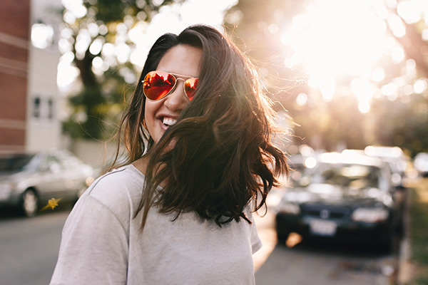 Girl wearing sunglasses smiling