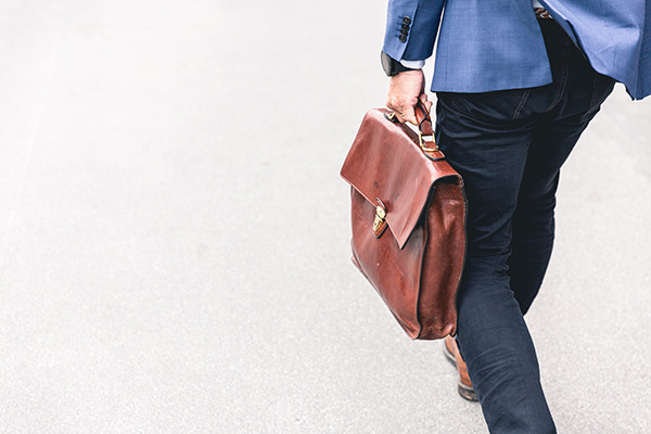 Man carrying briefcase on way to work