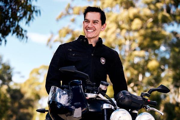Ben Arrow sitting on motorbike