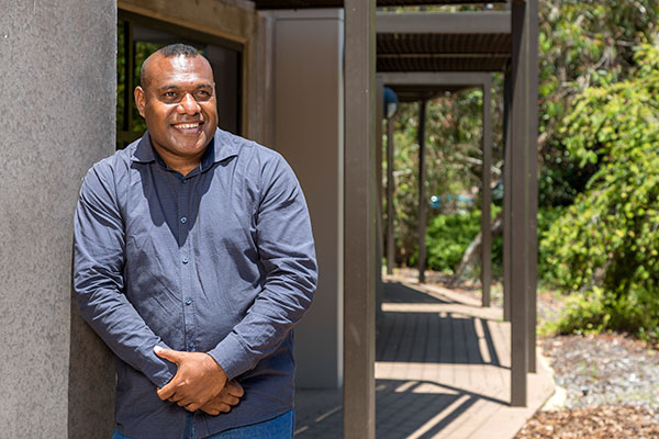 PNG student Benson Hahambu smiling outside