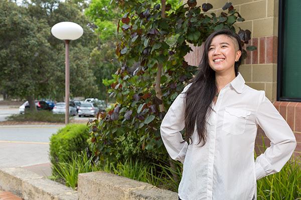 International student Chantal Ng posing and smiling at Murdoch University